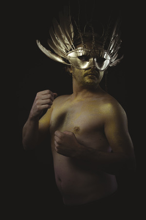 crusades: soldier, warrior helmet and gold feathers, giant iron sword Stock Photo
