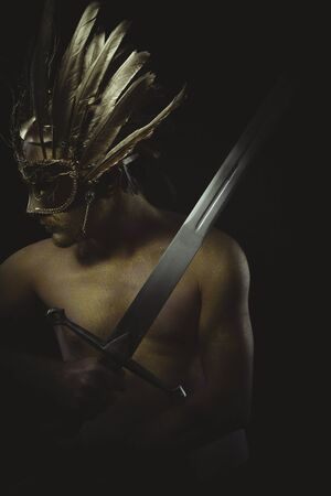 crusades: vintage warrior helmet and gold feathers, giant iron sword