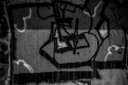 deface: segment of a street art grafitti in black and white ink