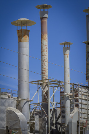 construction companies: tube and industrial chimneys in area construction companies Stock Photo