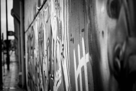 vandal: black ink grafitti design in city wall, street art segment