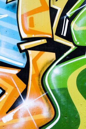 deface: drawings on a wall, segment of a graffiti