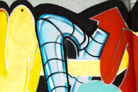 deface: typography and color lines, segment of an urban grafitti on wall