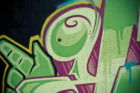 grafitti: typography and color lines, segment of an urban grafitti on wall
