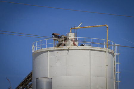 globalwarming: modern industry and refinery, warehouses and industrial tanks