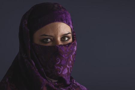 burqa: muslim, Beautiful arabic woman with traditional burqa veil
