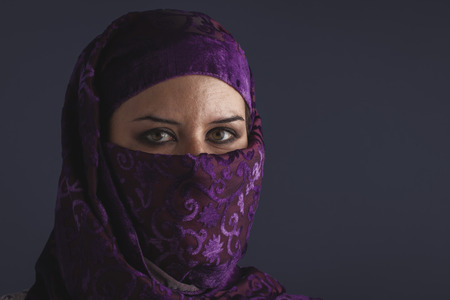 burqa: ethnic Beautiful arabic woman with traditional burqa veil Stock Photo