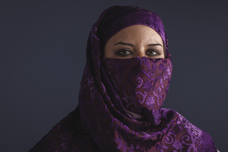 burqa: burka Beautiful arabic woman with traditional burqa veil Stock Photo