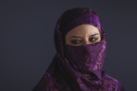 burqa: burka Beautiful arabic woman with traditional burqa veil Stock Photo