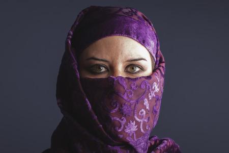 Beautiful arabic woman with traditional burqa veil
