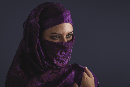 burqa: Beautiful arabic woman with traditional burqa veil