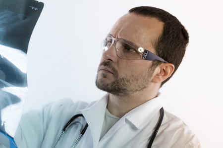 radiologist: Radiologist looking at an x-ray in hospital