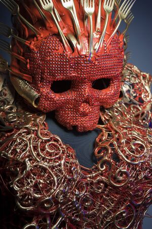 fantasy warrior: nightmare, bright red skull handmade fantasy warrior costume with gold and forms Stock Photo