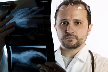 x ray equipment: Radiographer, Radiologist looking at an x-ray in hospital Stock Photo