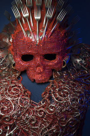 fantasy warrior: fashion bright red skull handmade fantasy warrior costume with gold and forms Stock Photo