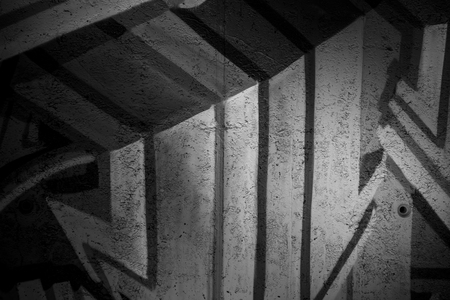 grafiti: a city wall with graffiti in black and white, urban art