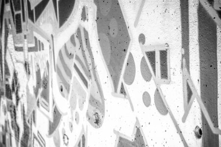 a city wall with graffiti in black and white, urban art
