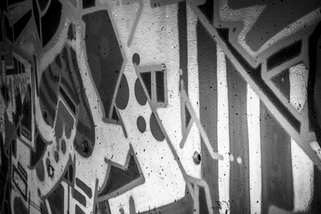 urban art: a city wall with graffiti in black and white, urban art