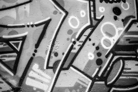 font, a city wall with graffiti in black and white, urban art