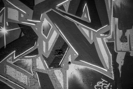 grafiti: font, a city wall with graffiti in black and white, urban art