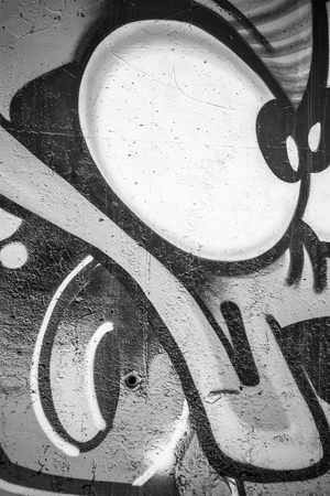 urban art: underground, a city wall with graffiti in black and white, urban art