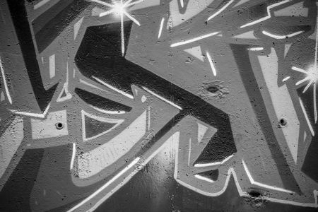graphiti: font, a city wall with graffiti in black and white, urban art