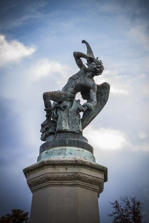 fallen angel: fallen angel, devil figure, bronze sculpture with demonic gargoyles and monsters Stock Photo