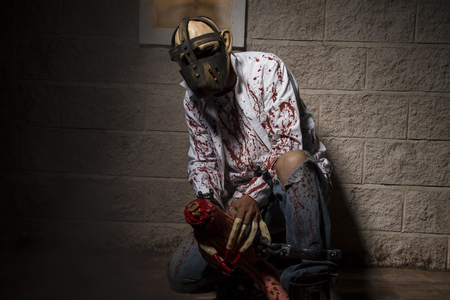 severed: horror, Man chained with blood and knife, has a severed leg blood