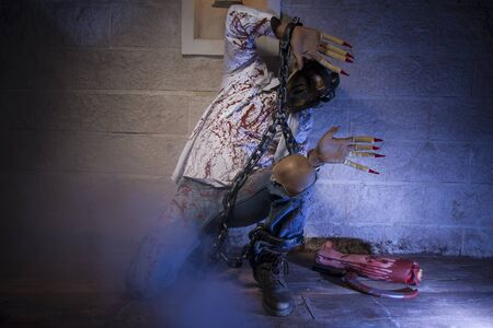 severed: fear, Man chained with blood and knife, has a severed leg blood