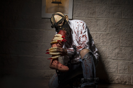diabolic: diabolic, halloween monster chained with bloody hook, night scene and terror Stock Photo