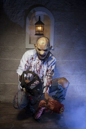 severed: criminal, Man chained with blood and knife, has a severed leg blood