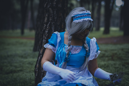 colore: dreams, alice in wonderland, girl in a forest with smoke colore and playing cards Stock Photo