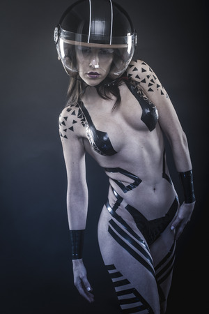 posing, adventure, sensual beautiful girl with hair white with black tape on the body and biker helmet Stock Photo