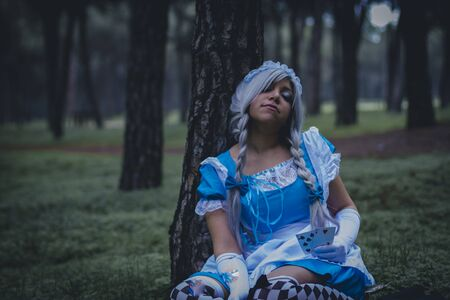 colore: alice in wonderland, girl in a forest with smoke colore and playing cards