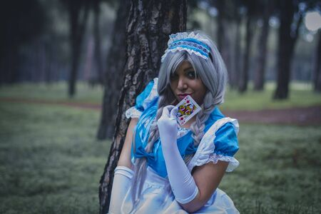 alice: imagination, alice in wonderland, girl in a forest with smoke colore and playing cards