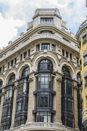 apartment tower old town: characteristic buildings on the street Gran Via in Madrid, capital of Spain