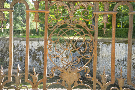 iron gate in an old nineteenth century style garden in Spain Stock Photo