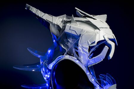 make up model: robotic spacesuit with blue lights and transparent sheets, futuristic armor