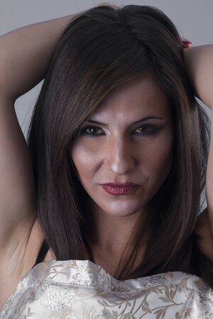 beautiful brunette girl with long hair and sensual look photo