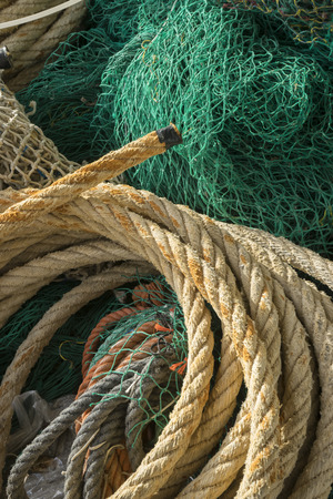 cords: rigs and fishing nets with a port in Mallorca, Spain. Detail of wires and cords