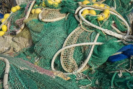 fishingnet: rigs and fishing nets with a port in Mallorca, Spain. Detail of wires and cords