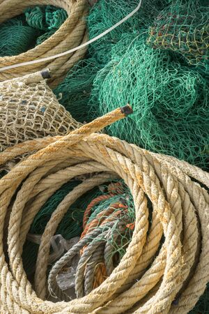 rudd: Fisherman, rigs and fishing nets with a port in Mallorca, Spain. Detail of wires and cords Stock Photo