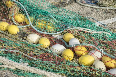 Boat, rigs and fishing nets with a port in Mallorca, Spain. Detail of wires and cords