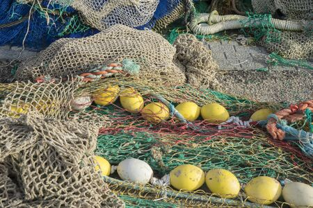 fishingnet: Rope, rigs and fishing nets with a port in Mallorca, Spain. Detail of wires and cords
