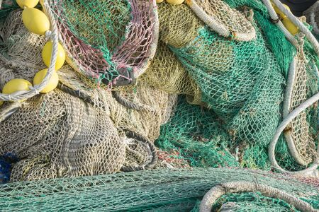 fishingnet: Fisherman, rigs and fishing nets with a port in Mallorca, Spain. Detail of wires and cords Stock Photo