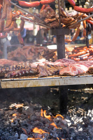 steak, medieval barbecue with sausages, octopus, meat, ribs and all kinds of traditional foods in Spainsteak, medieval barbecue with sausages, octopus, meat, ribs and all kinds of traditional foods in Spain