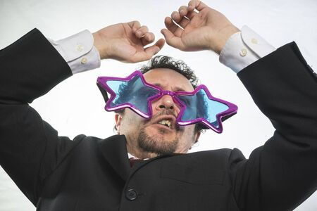 achiever: champion, businessman with glasses stars, crazy and funny achiever Stock Photo