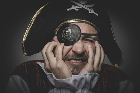 swashbuckler: Fear pirate with eye patch and old hat with funny faces and expressive Stock Photo