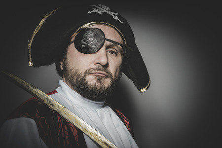 swashbuckler: man pirate with eye patch and old hat with funny faces and expressive