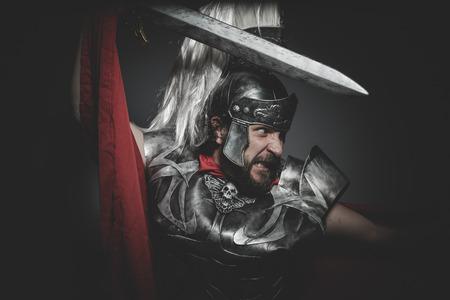 praetorian: Military, Praetorian Roman legionary and red cloak, armor and sword in war attitude Stock Photo